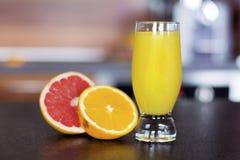 Glass of fresh orange juice on a kitchen countertop Royalty Free Stock Photo
