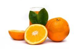 Glass of fresh orange juice and orange fruits. On white stock photo