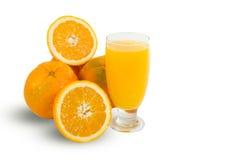 Glass of fresh orange juice with sliced oranges on white backgro Royalty Free Stock Image