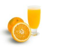 Glass of fresh orange juice with sliced oranges on white backgro Stock Photography