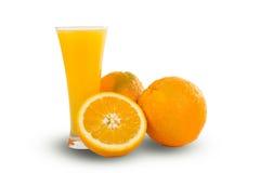 Glass of fresh orange juice with sliced oranges on white backgro Stock Photos