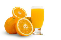 Glass of fresh orange juice with sliced oranges on white backgro Stock Image