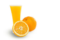 Glass of fresh orange juice with sliced oranges on white backgro Stock Photography