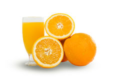 Glass of fresh orange juice with sliced oranges on white backgro Stock Photos