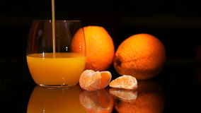A glass of Fresh Orange juice. In the Glass on the Table with Fruit stock video footage