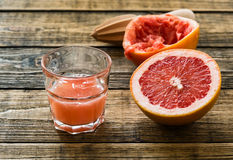 Glass of fresh organic pink grapefruit juice Royalty Free Stock Photo