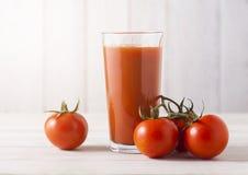 Glass of fresh organic tomato juice with tomatoes Stock Photo