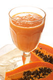 Glass of fresh papaya smoothie Royalty Free Stock Images