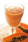 Glass of fresh papaya smoothie. With sliced papaya Royalty Free Stock Images