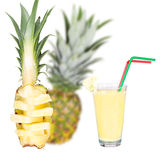 Glass of fresh pineapple milkshake Stock Images