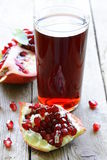 Glass of fresh pomegranate juice Stock Photo