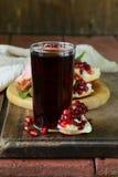 Glass of fresh pomegranate juice Royalty Free Stock Photo