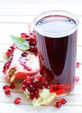 Glass of fresh pomegranate juice Royalty Free Stock Photography