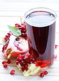Glass of fresh pomegranate juice Royalty Free Stock Photography