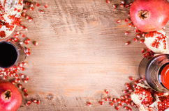 Glass of fresh pomegranate juice, seeds and fruits on wooden Royalty Free Stock Photo