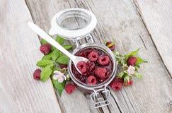 Glass with fresh Raspberry Jam. Glass with fresh homemade Raspberry Jam Stock Photos