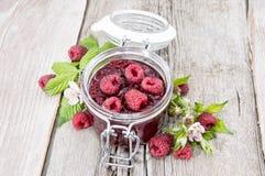 Glass with fresh Raspberry Jam. Glass with fresh homemade Raspberry Jam Stock Photo