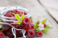 Glass with fresh Raspberry Jam. Glass with fresh homemade Raspberry Jam Royalty Free Stock Photography
