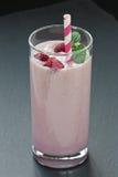 Glass fresh raspberry milkshake Stock Photos