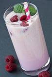 Glass fresh raspberry milkshake Royalty Free Stock Images