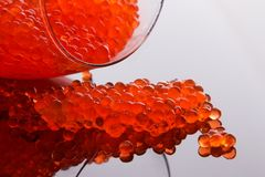 Glass with fresh red caviar. Overtroped glass with red caviar Royalty Free Stock Photo