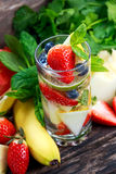 Glass of fresh strawberry detox water with fruit Stock Photography