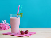 Glass of fresh strawberry milkshake. Healthy smoothie made as milk fruity cocktail. Strawberry coctail made from fresh strawberries. Healthy smoothie drink Royalty Free Stock Photo