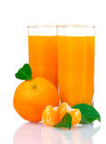 Glass of fresh tangerine juice Royalty Free Stock Photos