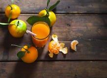 Glass of fresh tangerine juice with ripe tangerines Stock Photo