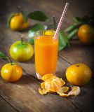 Glass of fresh tangerine juice with ripe tangerineswith old-fash Stock Image