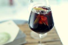 Glass with fresh tasty sangria. One glass  filled with fresh tasty sangria Royalty Free Stock Photo