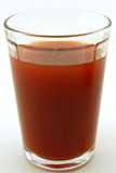 Glass of fresh tomato juice Stock Photography