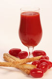 Glass of fresh tomato juice and cookies. Glass of tomato juice and cookies Royalty Free Stock Images