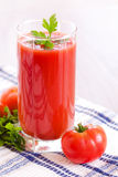 Glass of fresh tomato juice on the table Royalty Free Stock Photography