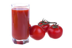 Glass of fresh tomato juice with tomatoes Royalty Free Stock Photo