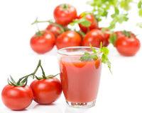 Glass of fresh tomato juice and tomatoes Royalty Free Stock Photo