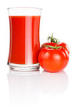 Glass of fresh tomato juice and two tomatoes Royalty Free Stock Photo