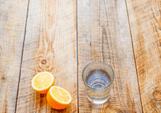 Glass of fresh water with halved lemon on wooden table Stock Photo