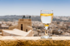 Glass of fresh water in sunlight of Gozo, Malta. Glass of fresh water on a terrace in sunlight of Gozo, Malta Stock Photography
