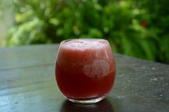 Watermelon juice. A glass of fresh watermelon juice - closeup Royalty Free Stock Images