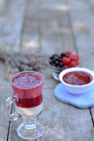 Glass of fresh yogurt with sweet, juicy raspberry and blackcurrant on foreground - healthy breakfast. Glass of fresh yogurt with sweet, juicy raspberry and Royalty Free Stock Images