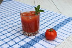 Glass of freshly squeezed tomato juice Royalty Free Stock Image