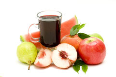 Glass of fruit juice and fresh fruits Stock Images