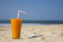 Glass of fruity cocktail. On the beach sand Stock Images