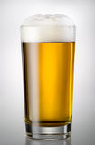 Glass full of beer and foam Stock Photo