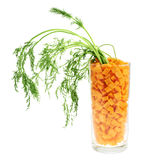 Glass full of carrot pieces isolated Stock Image
