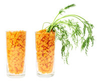 Glass full of carrot pieces isolated Stock Photography