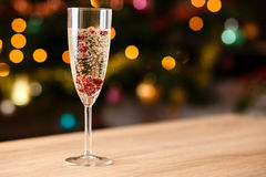 Glass full of champagne with cranberries Royalty Free Stock Photography