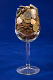 Glass full of Coins Stock Photography