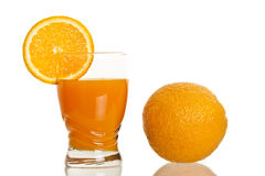 Glass full of fresh orange juice Stock Images